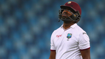 A dejected Darren Bravo walks back