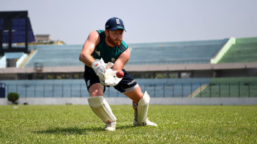 Jonny Bairstow prepares to resume behind the stumps