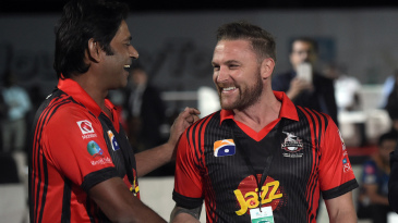 Brendon McCullum shakes hands with Aaqib Javed