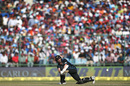 Kane Williamson sweeps with a packed stand in the background, India v New Zealand, 2nd ODI, Delhi, October 20, 2016