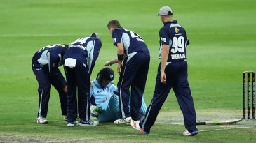 The Victorians check on Daniel Hughes after he was struck on the helmet by a bouncer