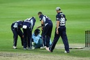 The Victorians check on Daniel Hughes after he was struck on the helmet by a bouncer, Victoria v New South Wales, Matador Cup 2016-17, elimination final, Sydney, October 21, 2016