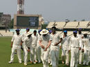 K Gowtham leads Karnataka off the field after their innings and 160-run win over Delhi at Eden Gardens in Kolkata, Karnataka v Delhi, Ranji Trophy 2016-17, Group B, 3rd day, October 22, 2016