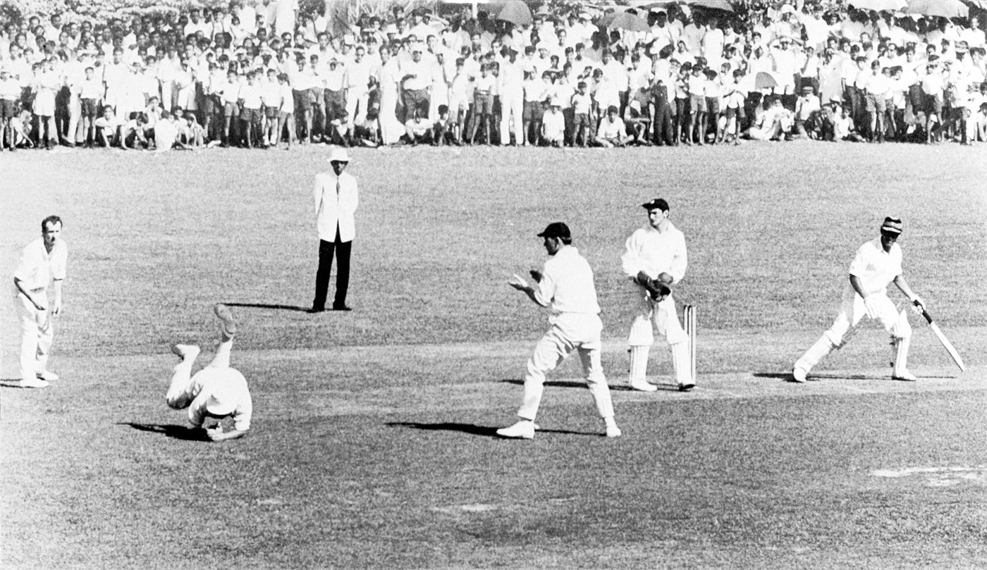 MC Cowdrey, playing for MCC, is watched by wicketkeeper APE Knott as he takes a catch at slip to dismiss Central Province's T Morrell off the bowling of DL Underwood in Kandy, 1969