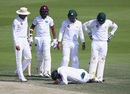 Team-mates check on Azhar Ali after he was struck, Pakistan v West Indies, 2nd Test, Abu Dhabi, 3rd day, October 23, 2016