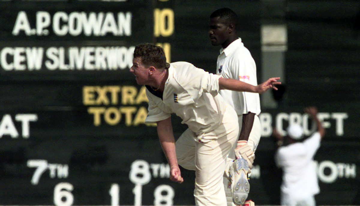 Robert Croft bowls against Guyana