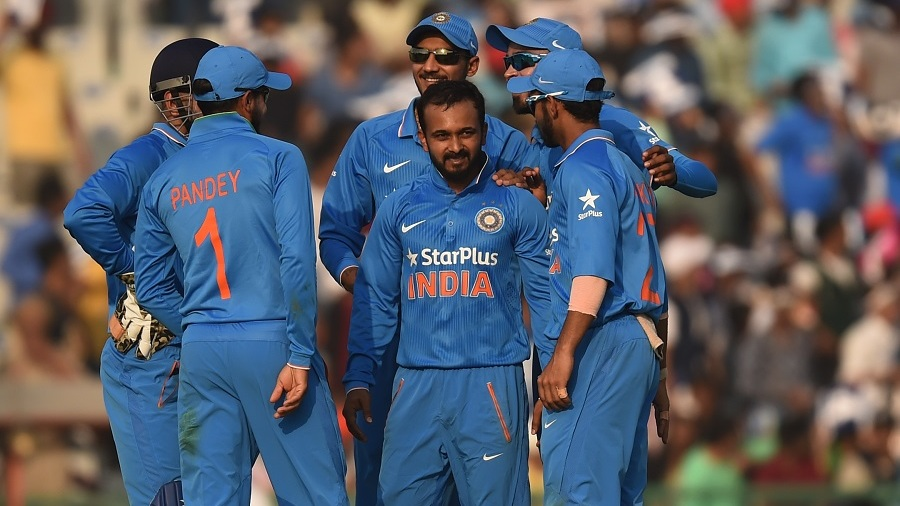 Kedar Jadhav celebrates with team-mates after taking a wicket