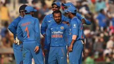 Kedar Jadhav celebrates with team-mates after taking a wicket