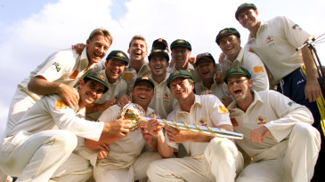 The Australian team poses with the Test mace