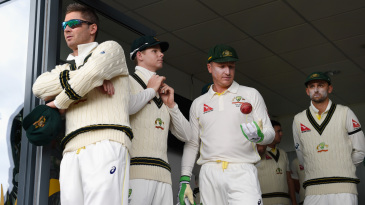Michael Clarke, Steven Smith, Brad Haddin and Nathan Lyon wait to walk on to the field
