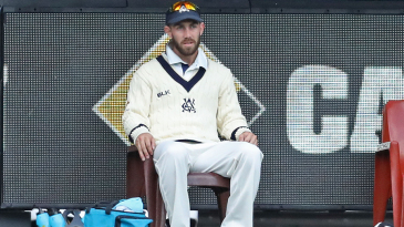 Glenn Maxwell sits near the boundary line after being named Victoria's twelfth man