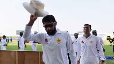 Misbah-ul-Haq leads his team off after clinching the series
