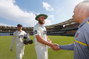 Doug Bollinger shakes hands with Usman Khawaja, Queensland v New South Wales, Sheffield Shield, Brisbane, 4th day, October 28, 2016