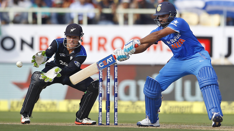 Rohit Sharma goes back to guide the ball