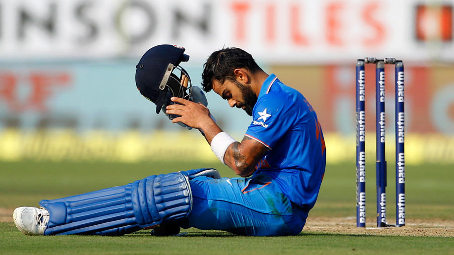 Virat Kohli gathers himself after slipping while running between the wickets