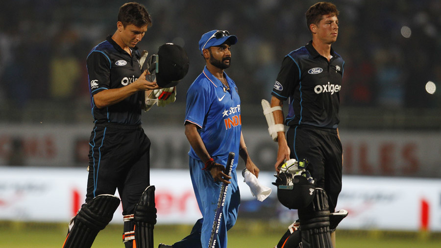 Amit Mishra walks off with NZ's final pair after the match