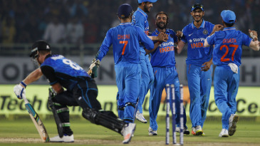 Amit Mishra celebrates after knocking James Neesham's middle stump