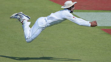 Mohammad Amir dives backwards to take a catch at covers