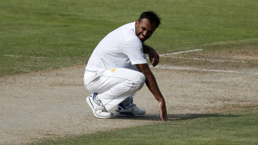 Wahab Riaz is on his haunches after a close call