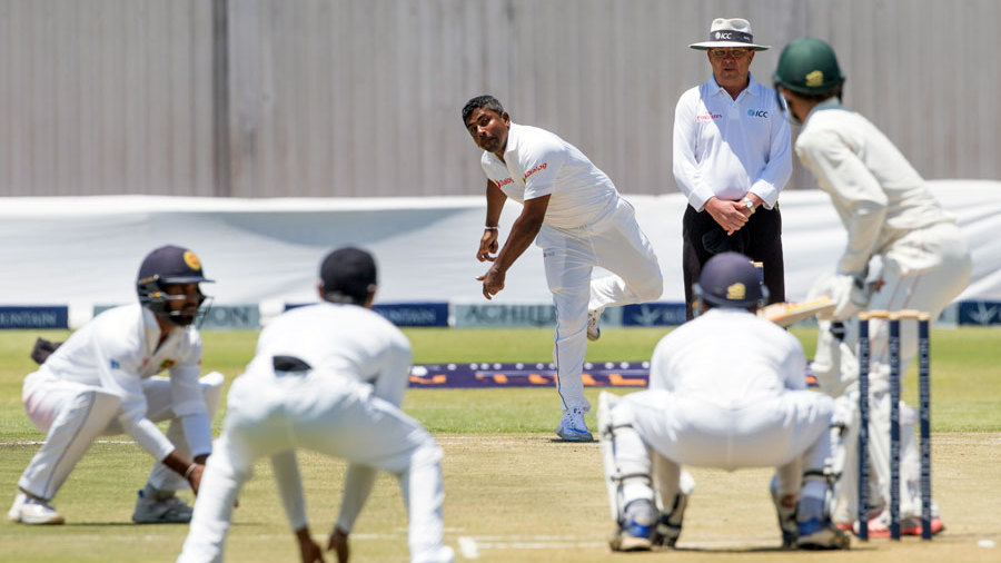 Rangana Herath bowls to a packed infield