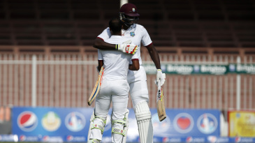 Jason Holder embraces centurion Kraigg Braithwaite