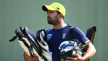 Tabraiz Shamsi carries his kit during training