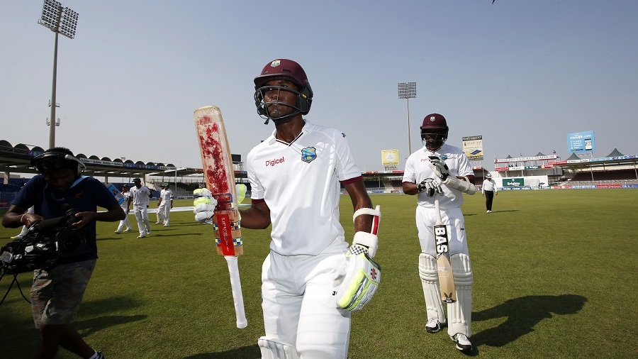 Kraigg Brathwaite walks off after making an unbeaten 142