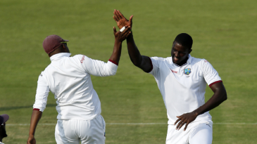 Jason Holder celebrates dismissing opener Sami Aslam