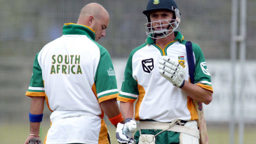 Alan Dawson walks past Herschelle Gibbs in training