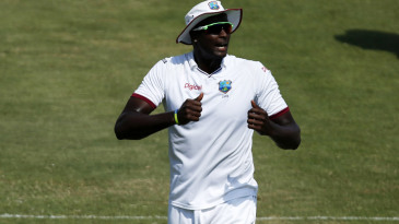 Jason Holder encourages his fielders