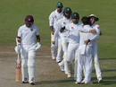 Pakistan fielders embrace Yasir Shah as Leon Johnson walks back to the dressing room, Pakistan v West Indies, 3rd Test, Sharjah, 4th day, November 2, 2016