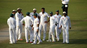 Pakistan wait for the third umpire's decision
