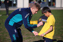 Sam Billings signs a t-shirt for a young cricketer at a Chance to Shine event, Teddington, November 2, 2016