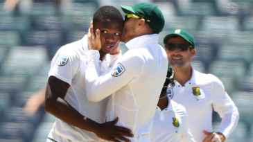 Faf du Plessis kisses Kagiso Rabada after the bowler took his fifth wicket