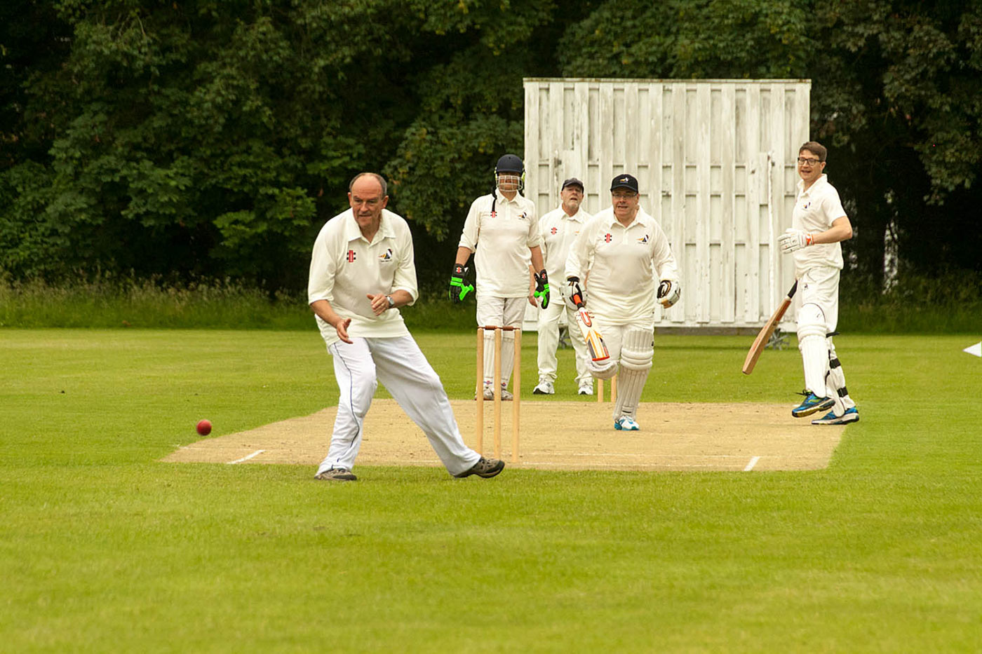 The senior tutor contemplates, commences and completes a run while his partner, regardless of his own safety, watches anxiously from half-way down the wicket