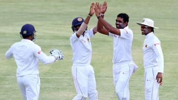 Dilruwan Perera celebrates after taking one of his three wickets