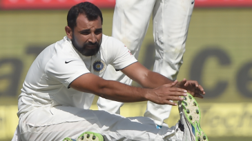 Mohammed Shami stretches after pulling his hamstring while bowling