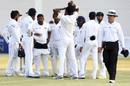 Rangana Herath and his team celebrate a wicket, Zimbabwe v Sri Lanka, 2nd Test, Harare, 4th day, November 9, 2016