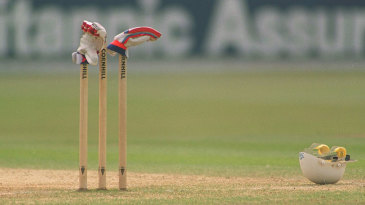 A pair of gloves rest on the wicket