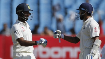Cheteshwar Pujara congratulates M Vijay on his 15th Test fifty