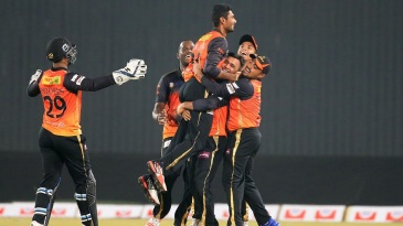 Mahmudullah is mobbed by team-mates after he bowled Khulna to a four-run win