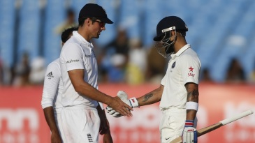 Virat Kohli and Alastair Cook shake hands to signal the end of the match