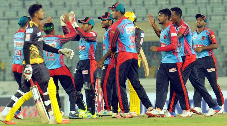 Barisal Bulls players congratulate each other after winning the match ...
