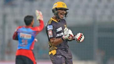 Sabbir Rahman punches the air with joy after reaching 100