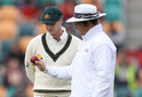 Aleem Dar and Steven Smith look at the ball, Australia v South Africa, 2nd Test, Hobart, 3rd day, November 14, 2016