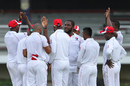 Roshon Primus celebrates with team-mates after taking a wicket, Trinidad & Tobago v Windward Islands, Regional Four-Day Competition, Port of Spain, 1st day, November 11, 2016