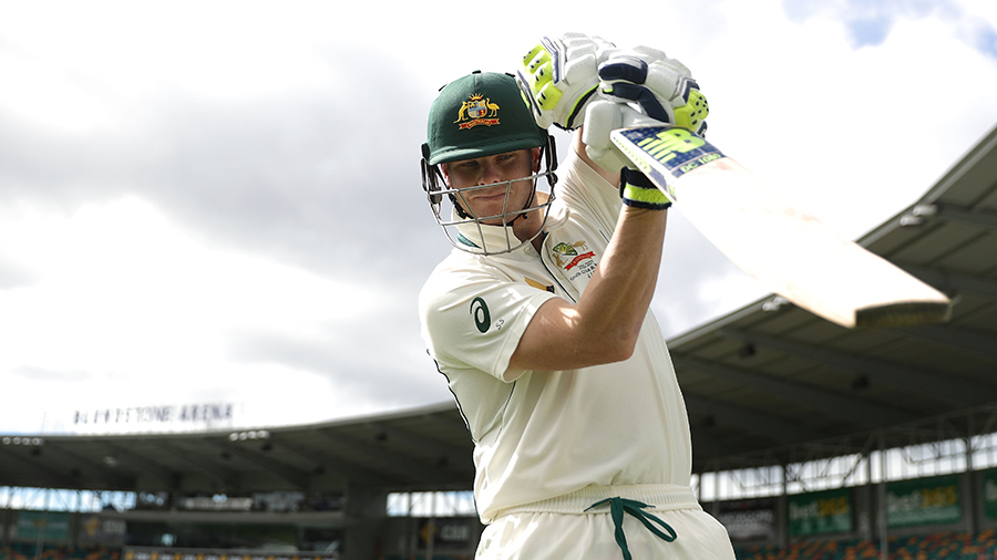Steven Smith walks out to bat on the fourth morning