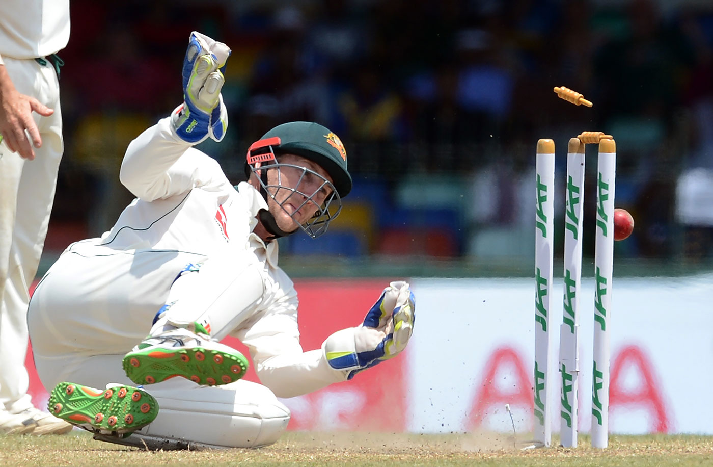 Not-so-safe hands: Peter Nevill's decision to wait a couple of seconds after collecting the ball to stump Dimuth Karunaratne, in fact, goes against the letter of the law