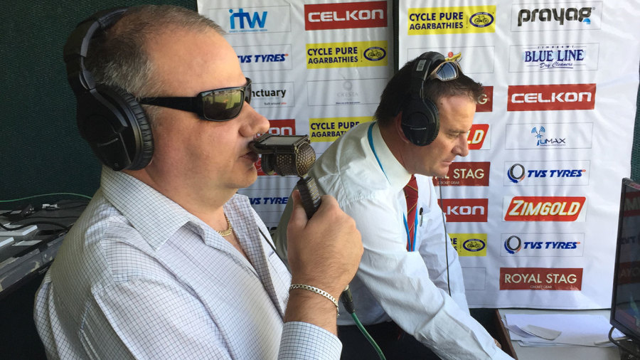 Visually impaired commentator Dean du Plessis behind the microphone