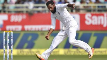 Adil Rashid fields the ball off his own bowling